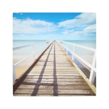 Beach Themed White pier on the ocean coast metal print