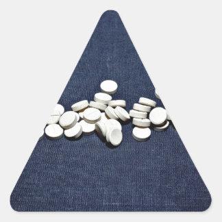 White pills glass bottle triangle sticker