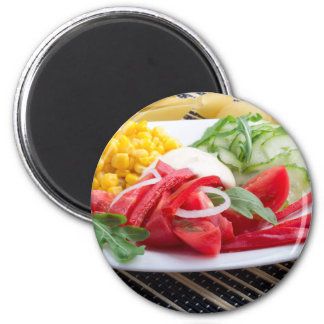 White plate with slices of fresh tomatoes magnet