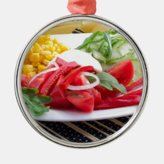 White plate with slices of fresh tomatoes metal ornament