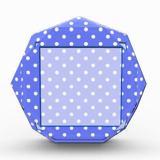 white polka dots in blue background. award