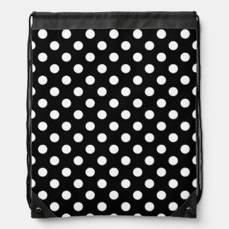 White Polka Dots on Black Background Drawstring Backpack