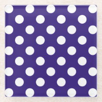 White polka dots on dark blue glass coaster