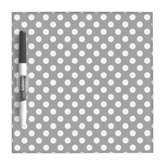White polka dots on grey dry erase board