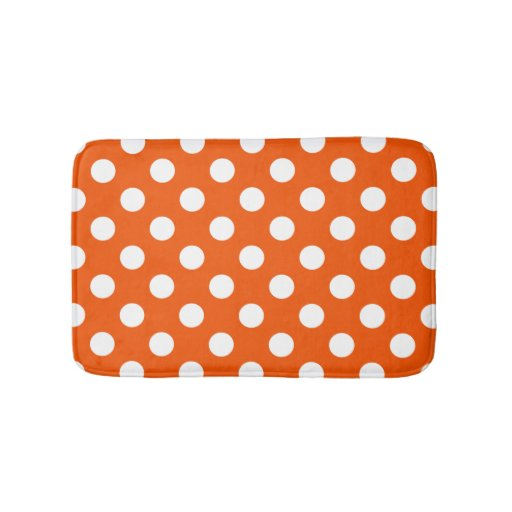 White polka dots on orange bath mat