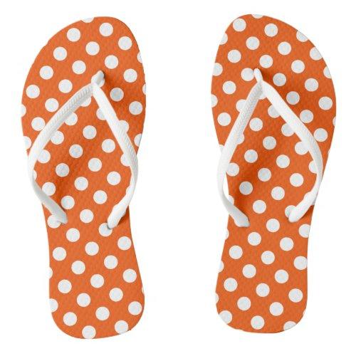 White polka dots on orange flip flops