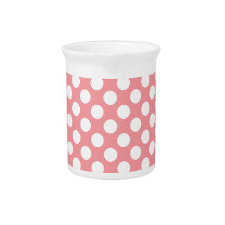 White polka dots on pink background pitcher