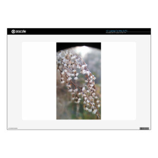 """white puffs of flowers streaming downwards 15"""" laptop skins"""