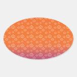 White pumpkins on orange purple fade oval sticker