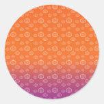 White pumpkins on orange purple fade round sticker