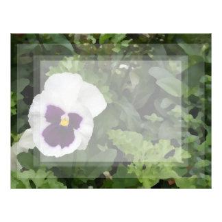 white purple pansy flower against green letterhead
