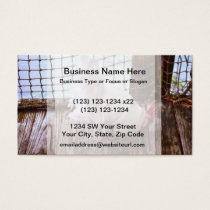 white rooster on dock eating business card