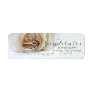 white rose and rings engagement announcement label