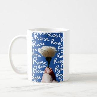 White rose, blue back, Rose written in white mug