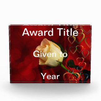 White rose on red background awards