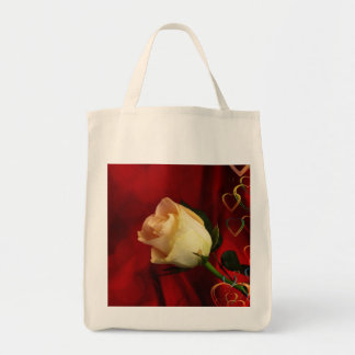 White rose on red background tote bag