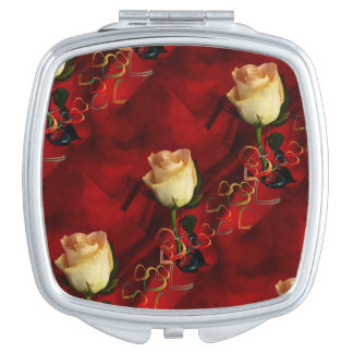 White rose on red background makeup mirror