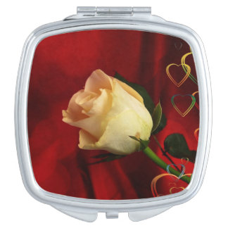 White rose on red background mirror for makeup