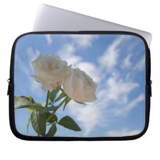 White Roses against Blue Sky Laptop Sleeves