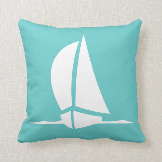 white sailboat  on teal blue pillow