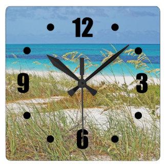 """WHITE SAND BEACH, SEA GRASS, BLUE-GREEN WATER"" SQUARE WALL CLOCK"