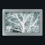 "White silhouetted tree rectangular belt buckle<br><div class=""desc"">White silhouetted tree against a winter blue background</div>"