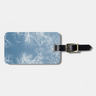 White silhouetted trees bag tag