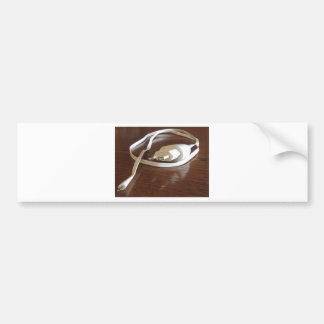 White smartphone charger on wooden table bumper sticker