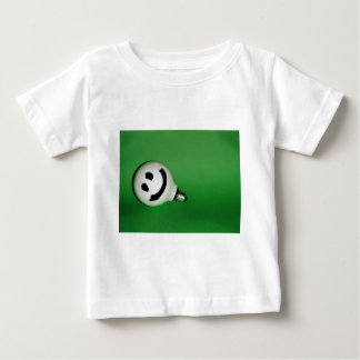 White smiling bulb on green background baby T-Shirt