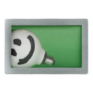 White smiling bulb on green background rectangular belt buckle