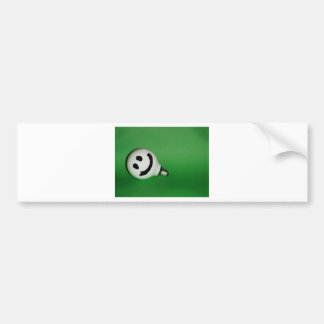 White smiling bulb on green background bumper sticker