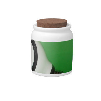 White smiling bulb on green background candy jar