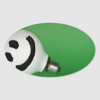 White smiling bulb on green background oval sticker