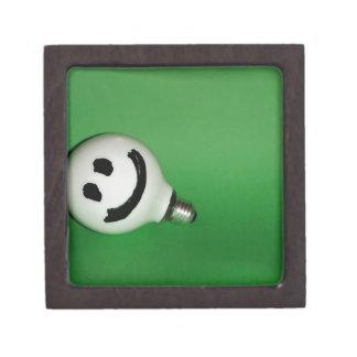 White smiling bulb on green background premium trinket boxes