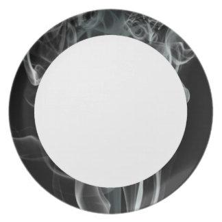 White smoke on black background dinner plate