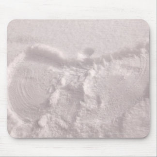 White snow imprinted with a snow angel mouse pad