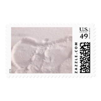 White snow imprinted with a snow angel postage stamp