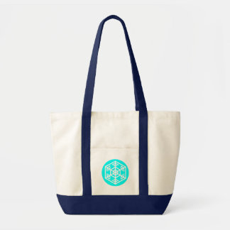 White snowflake in a light blue circle tote bag