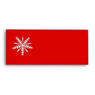 White snowflake on red xmas envelopes