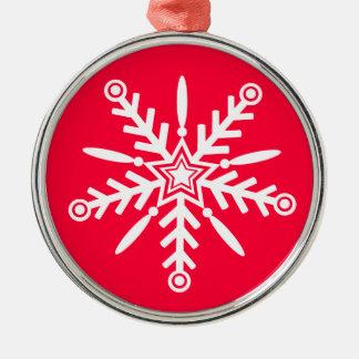 White snowflake on red xmas ornament