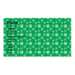 White snowflakes on green business cards