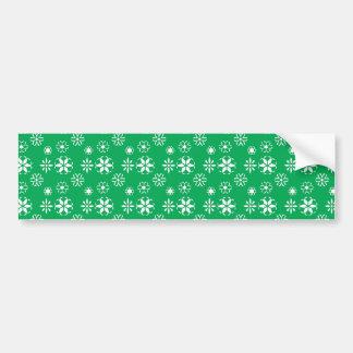 White snowflakes on green car bumper sticker