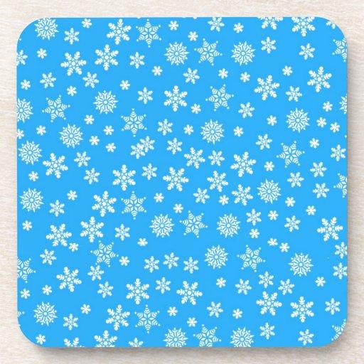 White Snowflakes on Light Blue  Background Beverage Coasters