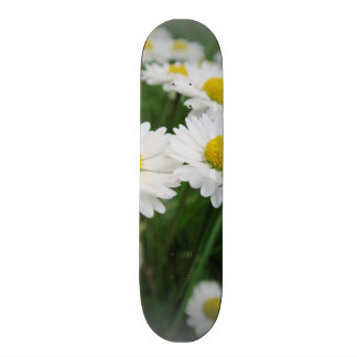 white spring flower in green grass skateboard deck