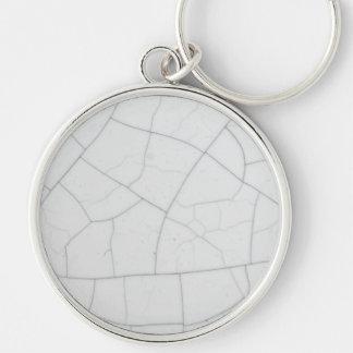 White stone cracks key chains