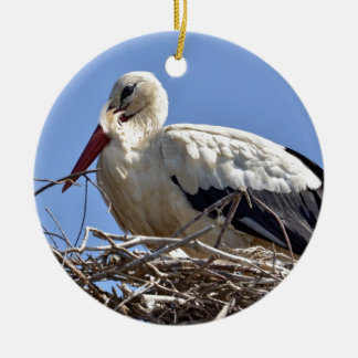 White stork in its nest ornaments