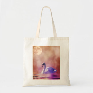 White Swan floating on a misty lake Tote Bag