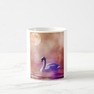 White Swan floating on a misty lake Coffee Mug