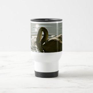 White swan on a pond in morning light travel mug