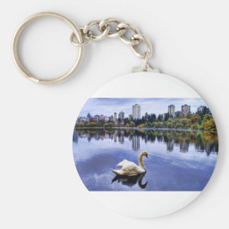 White Swan Swimming In The City Keychain